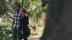 African American couple embracing and looking out at a river Stock Footage