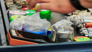 Man Arranges Pots for Hookah on Mobile Counter in Street Stock Footage
