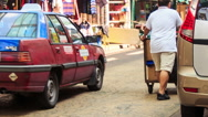 People Cars Carts Motion in Trade Street in China Town in KL Stock Footage