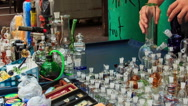 Man Arranges Hookahs Jars on Mobile Counter in Street Stock Footage