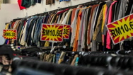 View of Racks with Different Jeans in Shop Stock Footage
