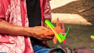 Street Vendor Launches Toy Helicopter Sitting on Pavement Stock Footage