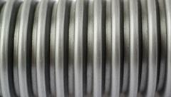 Part of Hand held small vacuum cleaner hose as texture background Stock Photos