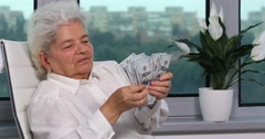 Caucasian Old Woman Holding Us Dollars American Banknotes Counting Budget Money Stock Footage