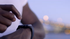 Closeup Of Man using His Smartwatch With City Lights In Background Stock Footage