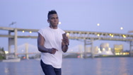 Man Listens To Music On His Smart Phone And Dances Along On The Waterfront Stock Footage