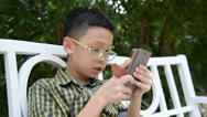 Child playing game on smart phone Stock Footage