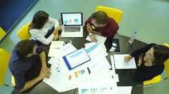 People, statistics and team work concept - close up of creative team sitting at Stock Footage
