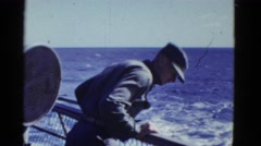 1952: ship on open sea, crew working, man leans over to look over the side SAN Stock Footage