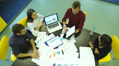 Creative work. Top view of business people working together while sitting at the Stock Footage