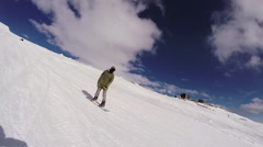 Men snowboarding down a mountain. Stock Footage