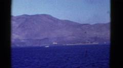 1952: a beautiful snow capped mountain ridge on a large body of water  Stock Footage
