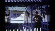 1952: an officer in uniform scribbles something and others are playing  Stock Footage