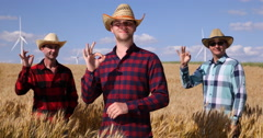 Team of Smiling Wheat Cultivator Men Posing in Golden Meadow and Showing OK Sign Stock Footage