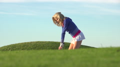 A woman playing golf. Arkistovideo