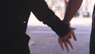 African American couple holding hands and walking, close up on their hands Stock Footage