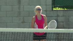 Women playing tennis. Stock Footage