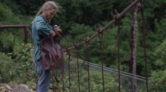 Abandoned Bridge - Photographer packing up camera Stock Footage