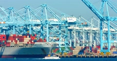 Cargo container ship and cranes during the heat wave in Los Angeles port 4K RAW Stock Footage