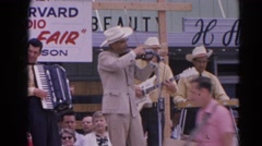 1964: a band is seen playing instruments in the open for people RACINE Stock Footage