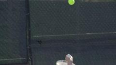 A racquet hitting a tennis ball. Stock Footage