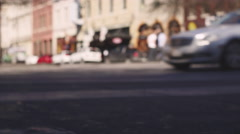 City street with cars driving by, out of focus Stock Footage