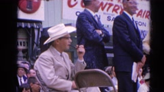 1964: a parade taking place with joy and people are seen enjoying RACINE Stock Footage