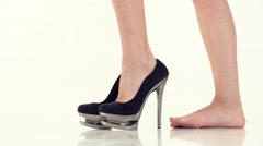 Woman wears beige shoes with high heels Stock Footage