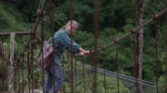 Abandoned Bridge - Traveller on Sketchy Path Stock Footage