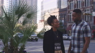 African American couple in the city talking and laughing Stock Footage