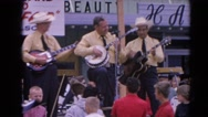 1964: musicians playing to a crowd of happy visitors RACINE, WISCONSIN Stock Footage