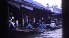 1962: a market on a boat area with water all around is seen BANGKOK Stock Footage