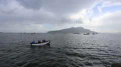 Small boat crossing Lamlash Bay, Arran Scotland Stock Footage