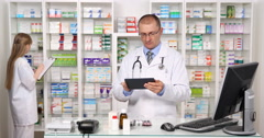 Modern Pharmacy Staff Activity Pharmacist Man Woman Team Work Inventory Pills Stock Footage