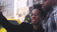 African American couple in a city taking pictures together Stock Footage