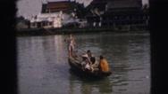 1962: lake, sea, water, yellow, jacket, friends, mens BANGKOK Stock Footage