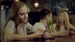 Woman texting in the bar Stock Footage