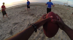 A group of young men playing flag football on the beach. Stock Footage