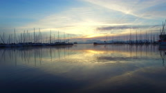 Aerial yachts in marina on lake in the morning Stock Footage