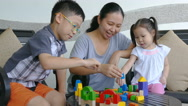 Children and mother playing with colorful construction blocks Stock Footage