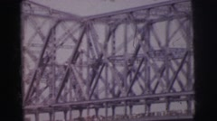 1962: a bridge is seen from a mountain area with greenery and trees Stock Footage