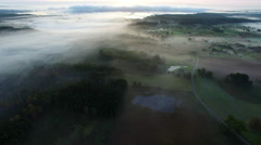 Aerial View Of Fog Mist Over Rural Countryside Stock Footage