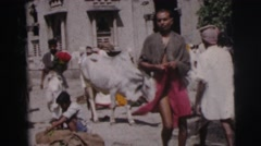1962: man walks through a crowd of people gathered around a plaza CALCUTTA Stock Footage