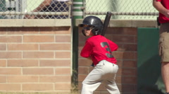 A boy at bat while playing little league baseball. Stock Footage