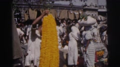 1962: a market area beside a road area is seen CALCUTTA Stock Footage