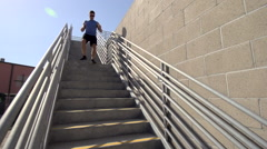 A man running stairs. Stock Footage