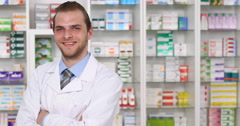 Attractive Young Pharmaceutist Man Smiling Looking Camera Drugstore Presentation Stock Footage