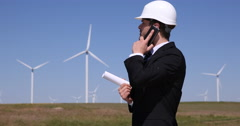 Young Businessman Talking Smart Telephone Gadget Power Generation Wind Turbines Stock Footage