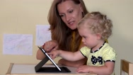 Babysitter teaching little child girl using tablet computer Stock Footage