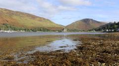 Lochranza Castle with Loch Ranza, Isle of Arran Scotland Stock Footage